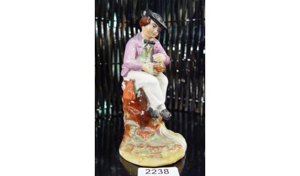 Oud porseleinen polychroom beeld